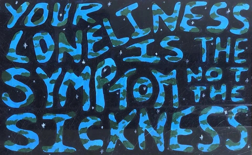 Amber Frizzell's artwork spells out the phrase 'Your loneliness is the symptom not the sickness' in a font that is coloured like the earth.