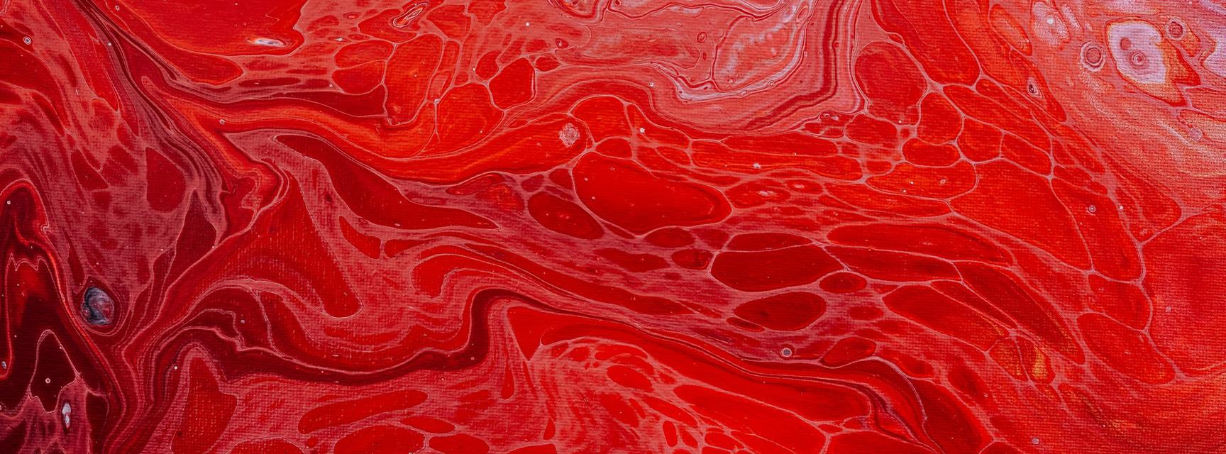Pattern of swirling red oil