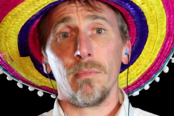John McCraw wears a multicoloured sombrero.