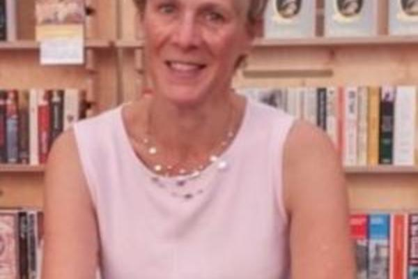 Kirsten Shepherd-Barr sits at a signing of her book, Modern Drama: a very short introduction