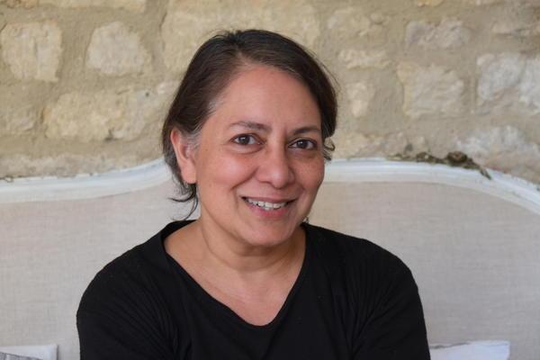 Photo of Sunetra Gupta smiling.